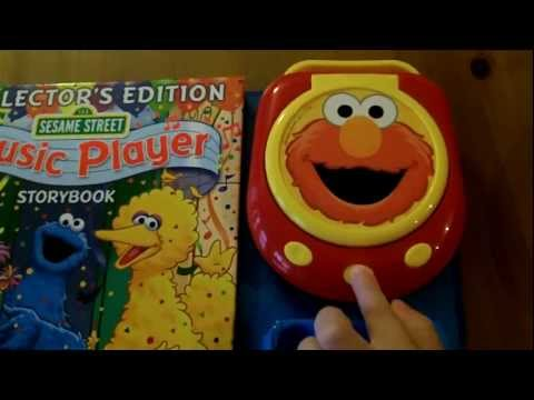 Sesame Street Music Player Storybook [With Music Player & 4 CDs] - Elmo CD Player