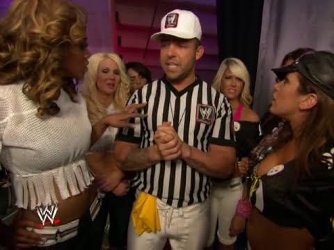 Santino Marella attempts to calm down the Divas