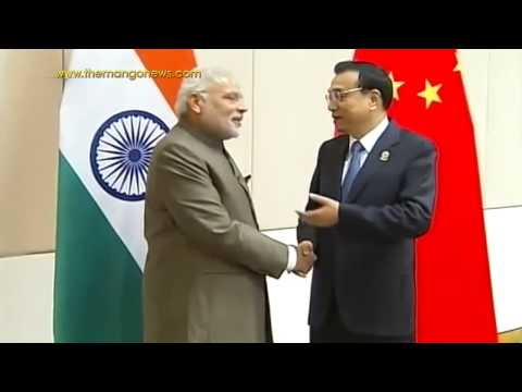 PM Modi meets Chinese Premier Li Keqiang in Myanmar at East Asia Summit