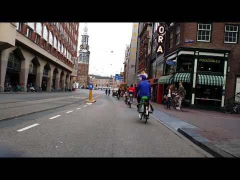 Sightseeing in Amsterdam on a bicycle via the Red Light District from South to the Central Station