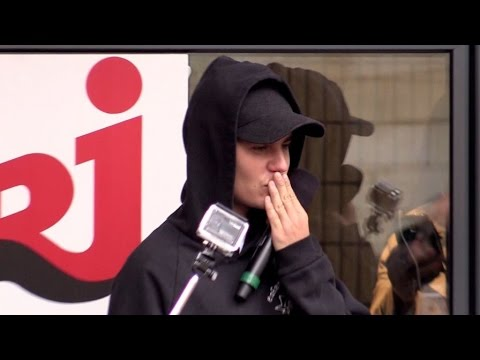 Justin Bieber cheering the fans at NRJ radio station in Paris