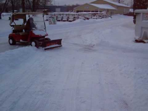 Golfcart plowing with  EZGO in deep snow