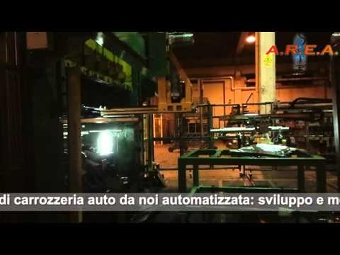 Automazione per linea di produzione: robot antropomorfi - presse - feeder