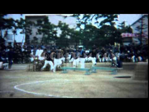1961: Asian schoolboy obstacle course competition jump race. TOKYO, JAPAN