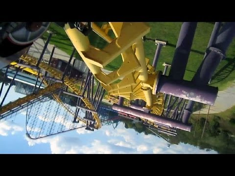 No, the camera is not upside down. This is a Vekoma Flying Dutchman coaster, where riders are tilted onto their backs & then flipped around into a 'flying' p...
