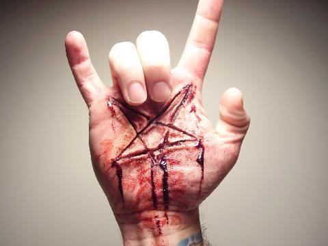 THE DEVIL'S HAND SIGN