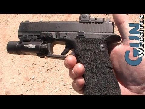 Modified 9mm Glock 19 w/ Trijicon RMR. Surefire