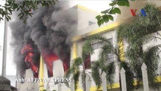 Người biểu tình phẫn nộ đốt các nhà máy để phản đối Trung Quốc