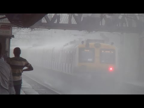 HEAVY RAINS -- A SUBURBAN MUMBAI STATION --  AND A WET BHEEGI BILLI TRAIN !!!!