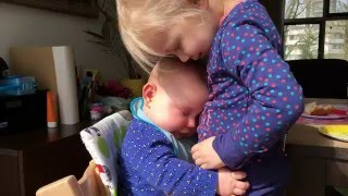This Baby Cuddling With Her Sister Will Melt Your Heart