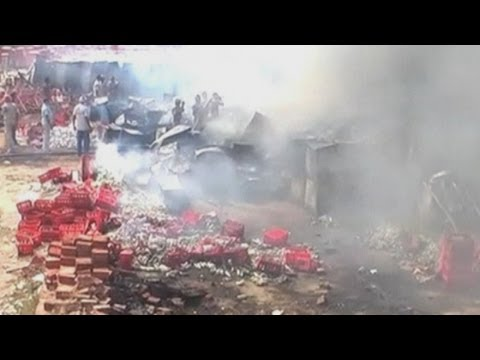 Flames engulf a Coca Cola depot in India's northern city of Lucknow
