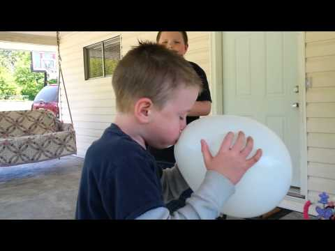 Cayden blowing up 1st balloon