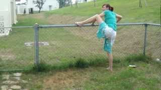 Drunken Wife Attempting to Hop a Fence