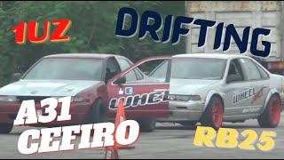Drift Relay - Cefiro Silver RB25 & Red 1UZ V8 - Wheel Art (Alvin)