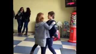 Girl trying to kiss a boy