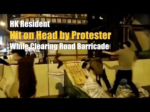 HK resident hit on head by protester while clearing road barricade | 香港市民清路障被暴徒襲擊頭部