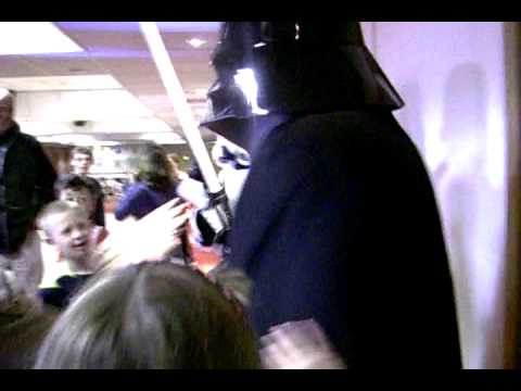 Darth Vader and Stormtrooper surprise kids at a party