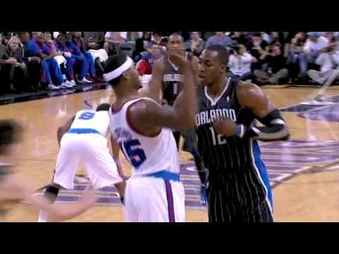 Dwight Howard goes over DeMarcus Cousins and punches in a two-handed dunk