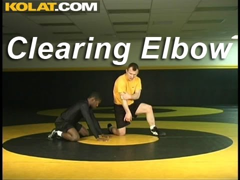 Front Headlock Clearing Elbow KOLAT.COM Wrestling Techniques Moves Instruction Image 1