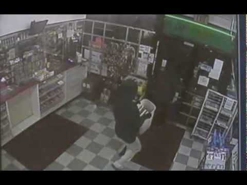 Terrifying Robbery Caught on Security Cam: Gun Stuck to clerks head