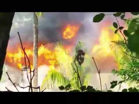 Firefighters battle two-alarm fire in Manoa