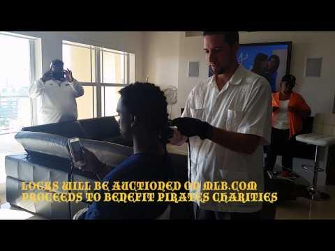 Andrew McCutchen Cuts Signature Locks For Charity (Hi-Res)
