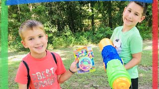 Kids playing in the woods with water guns!