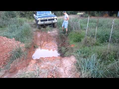 1975 Ford F100 Truck Playing in the Mud Hole