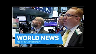 World News - The Dow finished above 26,000 on optimistic earnings