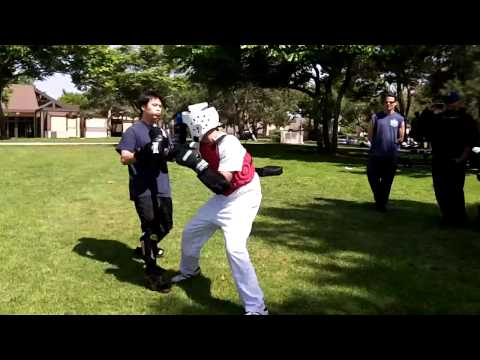 Tae Kwon Do (white headgear) vs Wing Chun Sparring Image 1