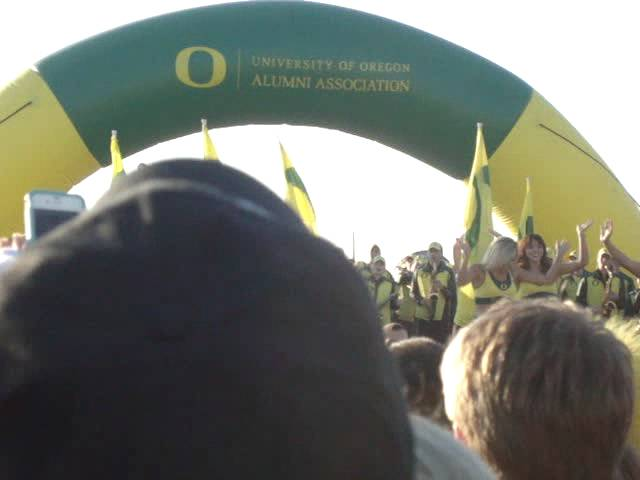 Oregon cheerleaders and marching band at the Oregon pep rally 1-01-2012