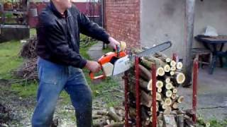 Cutting trees on stand with Stihl chainsaw