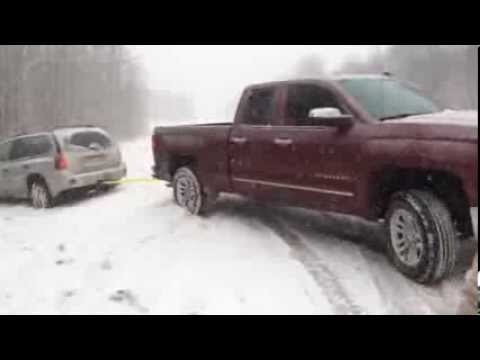 2014 Chevy Silverado LTZ pulls out SUV from ditch