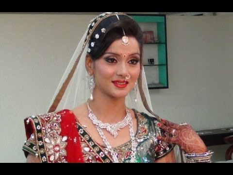 Indian Bridal Makeup And Hairstyle - Off White, Gold And Green Look