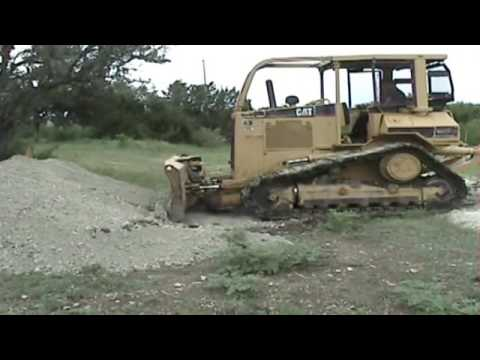 CAT D5M cuts a drainage ditch