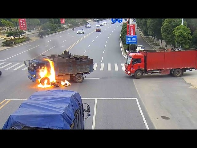 Footage: Fire engulfs motorcyclist after truck crash in southeast China