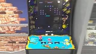 Playing arcade 1up Galaga