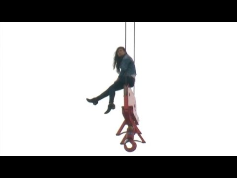 Woman gets stuck on top of crane