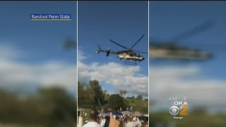 Low-Flying Police Helicopter Sends Tents, Corn Hole Games Flying At Penn State Tailgate