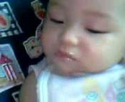 cute half japanese/filipina baby eatin while sleeping