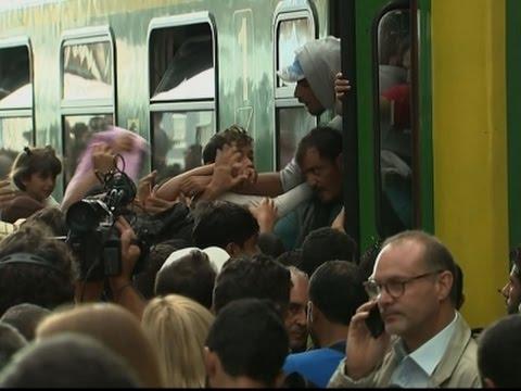 Raw: Migrants Flood Budapest Train Station