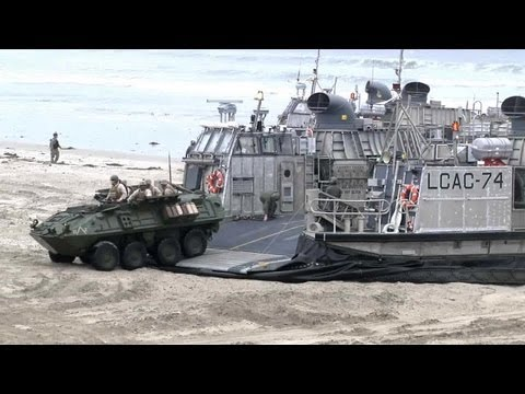 LCAC air-cushion vehicle landing and unloading LAV-25 amphibious vehicle. | AiirSource