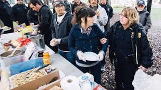 Police Arrest 7 People For Serving Food To The Homeless In Public Park