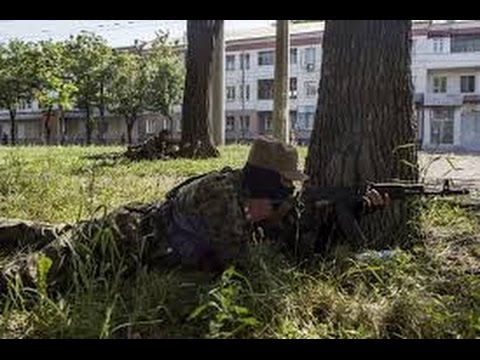 Empty streets, machine-gun nests, and rebels vowing to fight to the end.  That\'s Donetsk today as separatists turn it into a bastion they hope can withstand any Ukrainian military effort to oust them.  After being pushed out of Slovyansk on July 5, hundreds of pro-Russian fighters have fallen back to Donetsk and dug in for street warfare.   that separatists are setting up positions at key crossroads to rake them with crossfire. As Ukraine forces move in they need clear streets by street   \