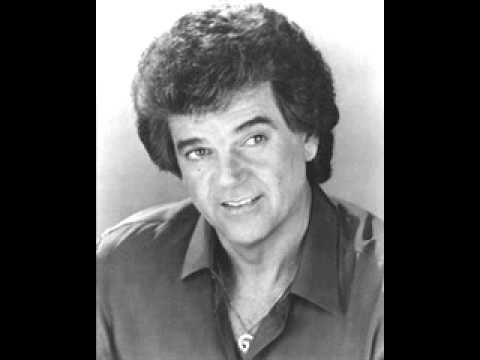 Lost in the Feeling by Conway Twitty.wmv