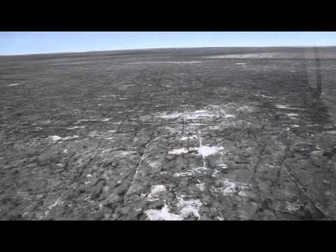 flying over dark Greenland ice