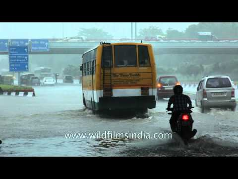 Heavy rains flood roads and halt traffic in Delhi