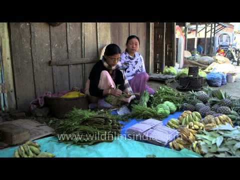 Woman selling local vegetables and fruits in Moirang Market of Manipur
