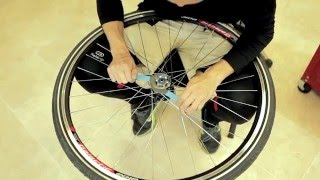 Stringbike hub backlash tuning