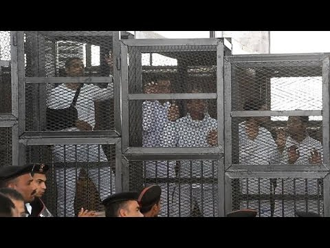 Al Jazeera journalists caged in court for falsehood trial